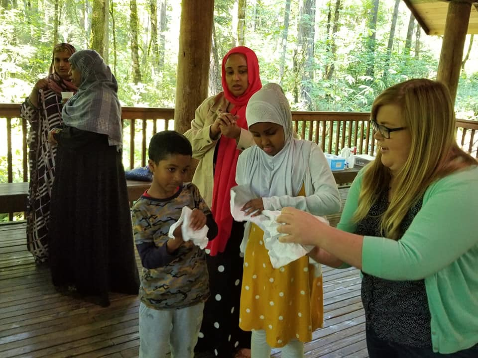 Alexis teaching children in the park shelter