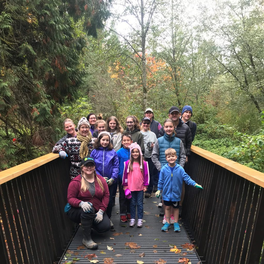 Group of 16 people on a bridge in the forest