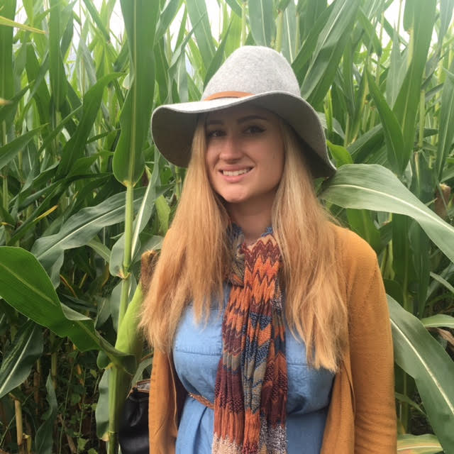 Jackie Brenner standing in a corn field.