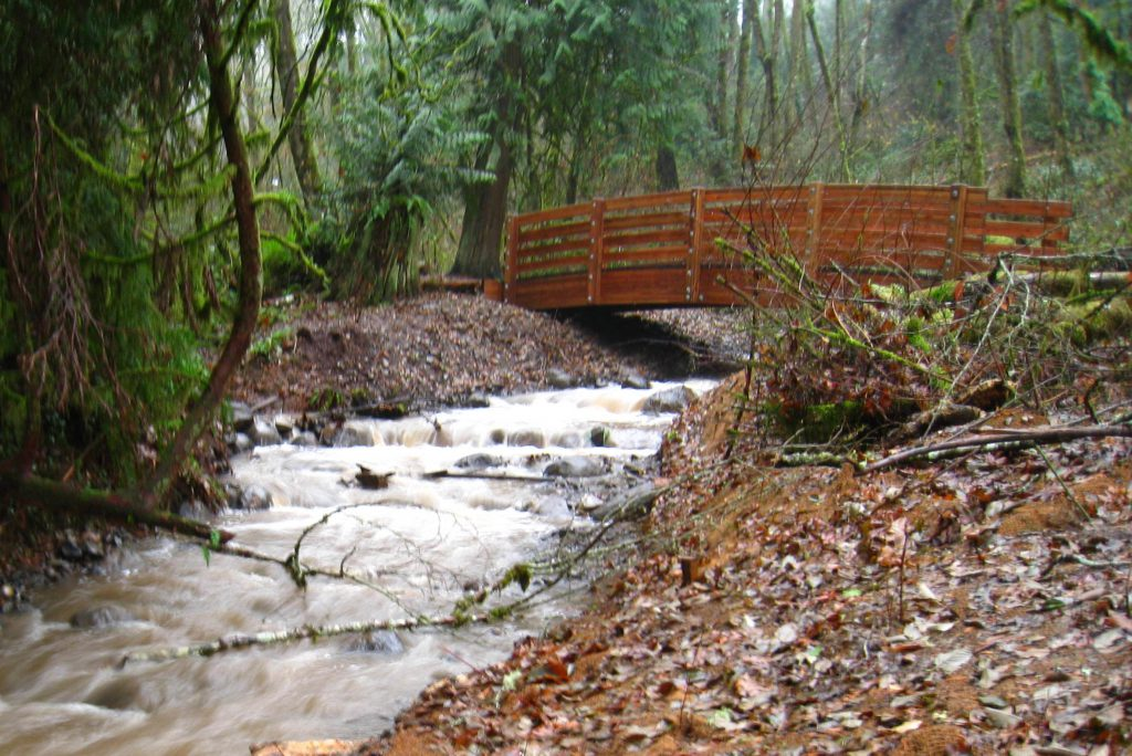 The new (2014) Nettle Creek Bridge in the Tryon Creek State Natural Area, which now allows migratory fish such as cutthroat trout to move beyond the former fish passage barrier to upstream habitat.